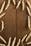 Ears of wheat on wood Stock Photography
