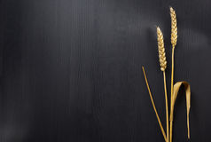 Ears of wheat on wood. En background Royalty Free Stock Image
