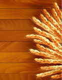 Ears of wheat on wooden background. Vector vector illustration