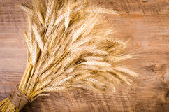 Ears of wheat on wooden background. Frame Stock Photo