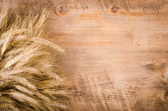 Ears of wheat on wooden background. Frame Royalty Free Stock Photo