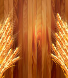 Ears of wheat on wooden background. Royalty Free Stock Photography