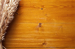 Ears of wheat on the wooden table. Stock Image