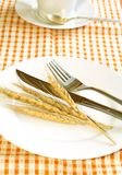 ears on white plate, fork and knife Royalty Free Stock Photo