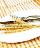ears on white plate, fork and knife Royalty Free Stock Image
