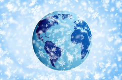 The Earth. In snow. Over blue snow background stock photography