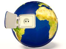 Earth. Electric plug in earth on white Stock Image