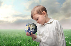 Earth. Child holding the earth in his hand Royalty Free Stock Images
