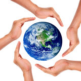 Earth. Hands around the world in signal of protection and conservation Stock Images