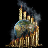 Earth. Globe with twisted diagram of golden coins in the fire. isolated on black Royalty Free Stock Images