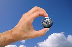 Earth. Male hand holding earth Royalty Free Stock Photos