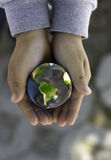 Earth. A child holds a globe in his hands. 3D rendered and post-composed. Mapping image from NASA Stock Image