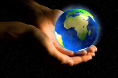 Earth. In woman hands: care, background Stock Photo
