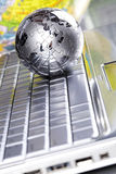Earth. Notebook & puzzle earth chrome globe Royalty Free Stock Photography