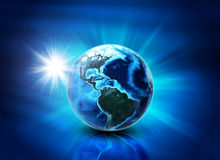 Earth on abstract blue background Stock Photo
