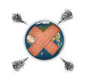 Earth with adhesive plaster Royalty Free Stock Image