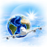 Earth with airplane against clouds and sun. Elements of this image are furnished by NASA Stock Image