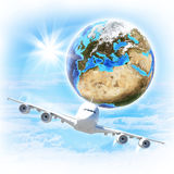Earth with airplane against clouds and sun. Elements of this image are furnished by NASA Royalty Free Stock Photography
