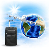 Earth with airplane and voyage bag Royalty Free Stock Image