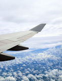 Earth and airplane wing. Viewing from a plane Royalty Free Stock Photography