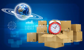 Earth and alarm clock on cardboard boxes Royalty Free Stock Image