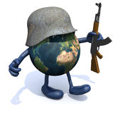 Earth with arms and legs, german helmet and rifle Royalty Free Stock Photos