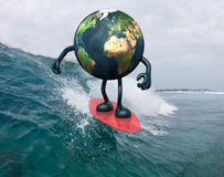 Earth with arms and legs surfing on the sea Royalty Free Stock Images