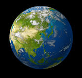 Earth Asia. Earth model planet featuring the continent of Asia including China Japan Korea and India surrounded by blue ocean and clouds on black Royalty Free Stock Photo