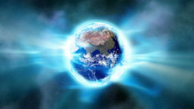 Earth Aura 001. An aura of light envelopes the Earth in space (Loop stock illustration