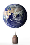 Earth balanced on oil. Nasa Goddard Space Flight Center supplied image of the earth from outer spaced balanced on an oil can stock photo