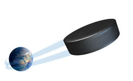 Earth With Ball Swoosh Isolated. A sporting concept showing a regular ice hockey puck swooshing out and above the earth onto an isolated white studio background Royalty Free Stock Photo