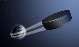Earth With Ball Swoosh In Space. A sporting concept showing a regular ice hockey puck swooshing out and above the earth onto a starry space background Royalty Free Stock Photography