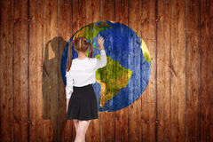 Earth ball texture on wood background. Woman stands near earth ball texture on wood background. Elements of this image furnished by NASA stock photo