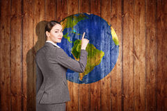 Earth ball texture on wood background. Woman stands near earth ball texture on wood background. Elements of this image furnished by NASA stock images