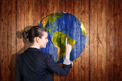 Earth ball texture on wood background. Woman stands near earth ball texture on wood background. Elements of this image furnished by NASA royalty free stock photos