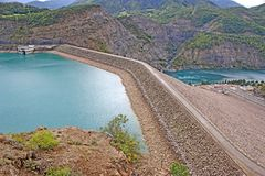 Barrage of Serre Poncon, France. Earth barrage on the Derre Poncon Lake in the French Alps stock image