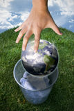 Earth being droppen in the trash. Conceptual image of Earth being dropped in the trash Royalty Free Stock Photo
