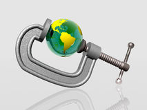 Earth being squeezed with clamp Royalty Free Stock Photo