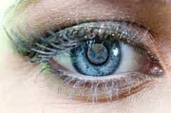 Earth Blue Eye. Blue Eye of Woman with with focus on Planet Earth Reflection, parts of this image furnished by NASA royalty free stock photos