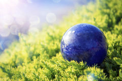 Earth -- blue marble. Our beautiful planet as a blue stone in greenery bathing in sun rays royalty free stock photos
