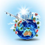 Earth with buildings and airplane Royalty Free Stock Images
