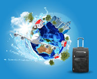 Earth with buildings, airplane and voyage bag Stock Images