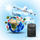 Earth with buildings, airplane and voyage bag Royalty Free Stock Photography