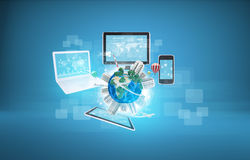 Earth with buildings and laptop, tablets, Royalty Free Stock Photos