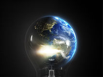 Earth in bulb Royalty Free Stock Images