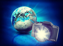 Earth and camera on abstract blue background Royalty Free Stock Photography