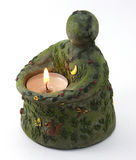 Earth Candle. Depiction of Mother Earth with a candle lit as a metaphor for global warming and healing the ecology of the planet Stock Photos