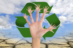 Earth care. Tree made of hands with recycle symbol over a dry soil Stock Photo