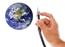 Earth Care. With Stethoscope In Hand Royalty Free Stock Photo