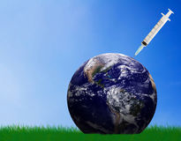 Earth Care Concept. Heal and care the earth concept, hand and blue planet on green grass background, nature and ecology, Elements of this Image Furnished by NASA Royalty Free Stock Photo